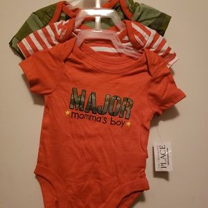 A 3 piece set of never worn with tags onesies